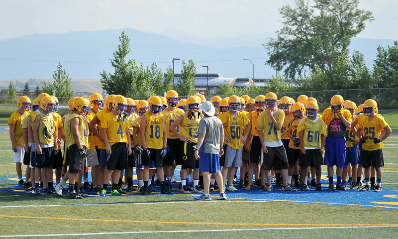 Sheridan High School head football coach Don Julian gives a pep talk at the beginning of their first practice of the season on Monday at Sheridan High School. The Broncs kick off the season on August 29 at home against Laramie. The Sheridan Press Mike Pruden