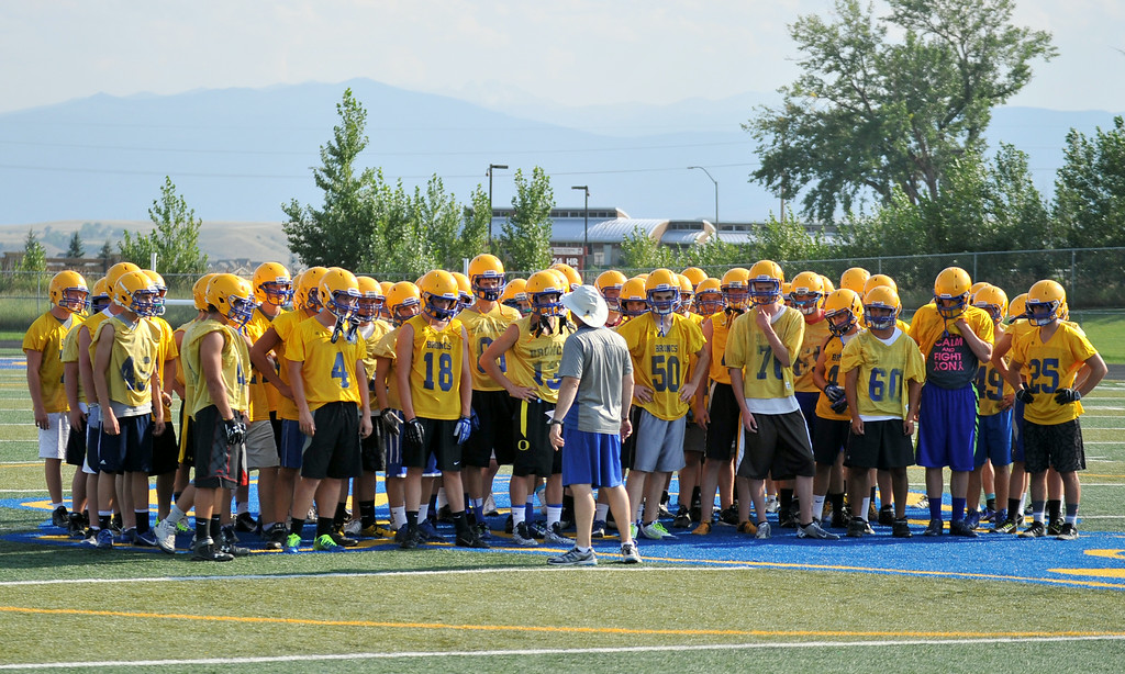 Sheridan High School head football coach Don Julian gives a pep talk at the beginning of their first practice of the season on Monday at Sheridan High School. The Broncs kick off the season on August 29 at home against Laramie. The Sheridan Press|Mike Pruden