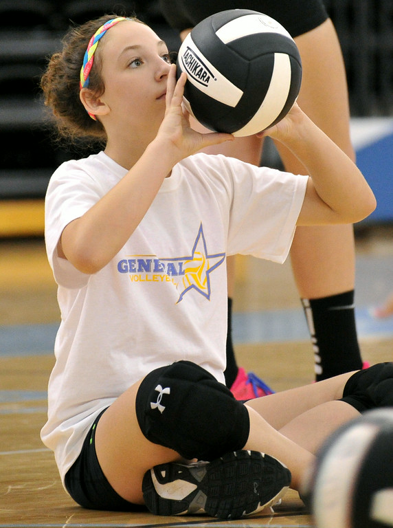 Sophia Calkins practices her setting during a drill on Tuesday at the Sheridan College Volleyball Camp. The Sheridan Press|Mike Pruden