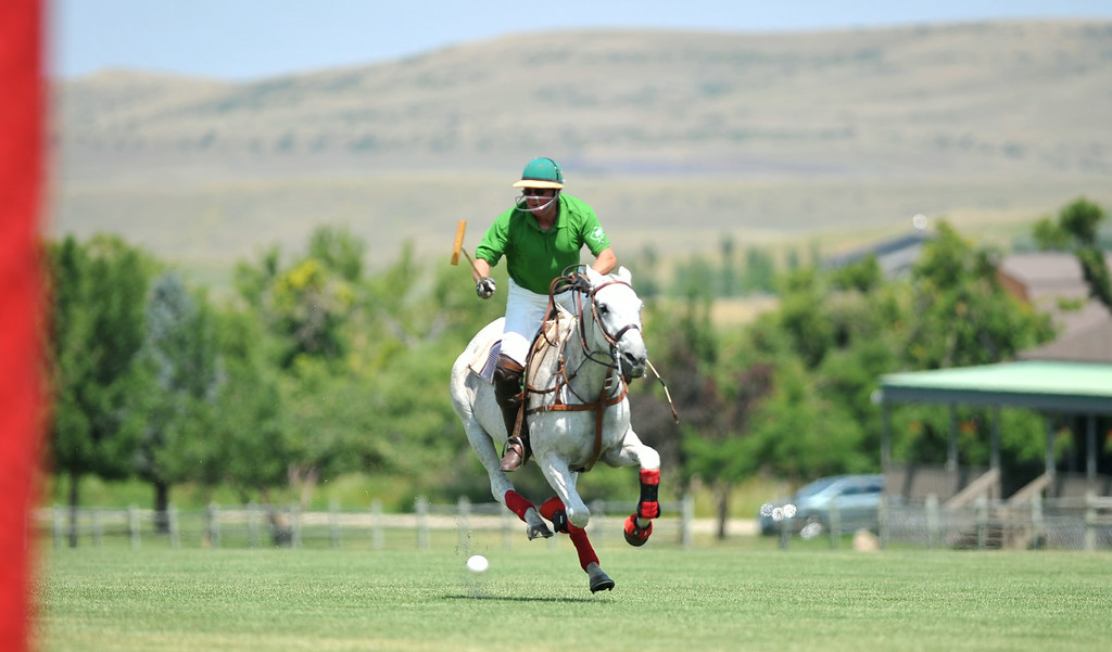 Sheridan Seed's Bob Brotherton breaks ahead of the pack on his way to a goal on Sunday at the Big Horn Polo Club. The Sheridan Press|Mike Pruden