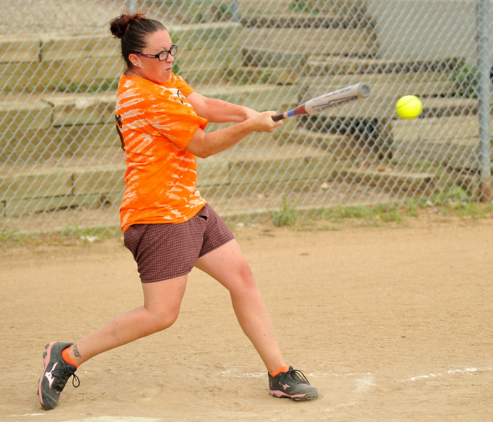 Shelbi Wood drives the ball to the outfield for a single on Wednesday at the Sheridan Community Softball Complex. The Women's League began their tournament yesterday at the complex. The Sheridan Press|Mike Pruden