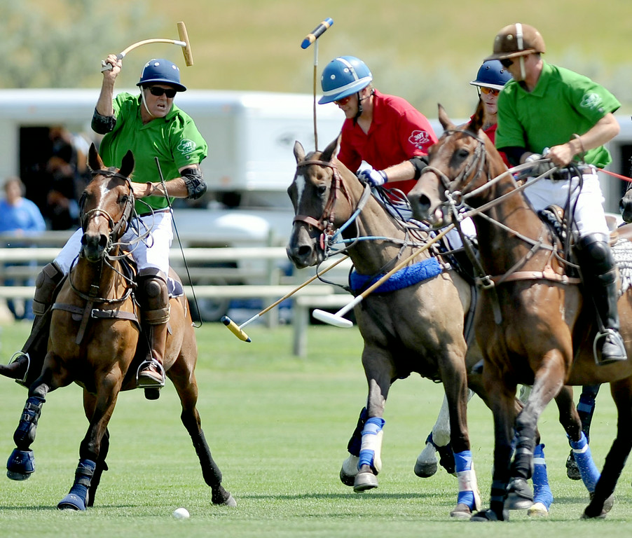 Players from Sheridan Seed and Big Horn Beverage battle for posession of the ball on Sunday at the Big Horn Polo Club. The Sheridan Press|Mike Pruden