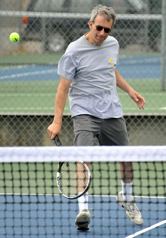 Rick Schmierer hits a backhand during a mixed doubles match at the 2014 J.D. Mullinax Memorial Tennis Tournament on Saturday at Thorne-Rider Park. The Sheridan Press|Mike Pruden