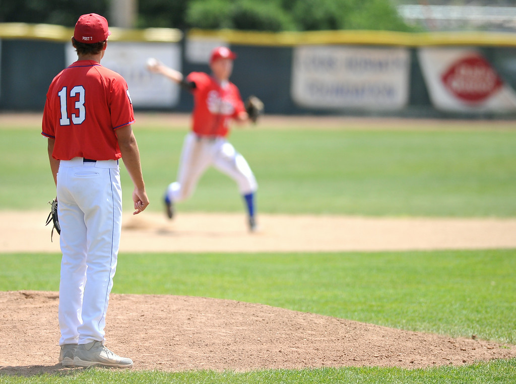 Sheridan Troopers pitcher Blake Godwin, left, watches as his shortstop Connor McCafferty throws for an out on Monday at Thorne-Rider Stadium. The Sheridan Press|Mike Pruden