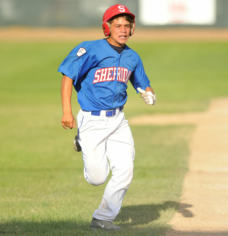 Blake King rounds sprints to home plate to score a run for the Sheridan Jets on Monday at Thorne-Rider Stadium. The Jets won both games of their doubleheader against Lovell. The Sheridan Press|Mike Pruden