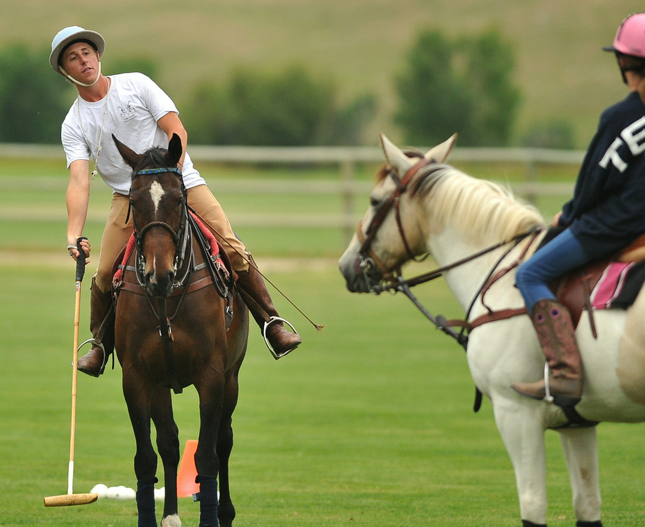 Ethan Galis gives an instruction on how to swing a mallet last week at the Big Horn Polo Club. Galis gives both public and private lessons every week at the club. The Sheridan Press|Mike Pruden