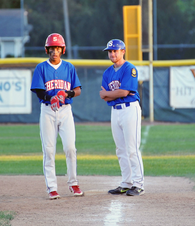 Jets' Dominic Miller talks to coach Cole Gustafson at first base on Saturday night. The Sheridan Press/Kendra Cousineau