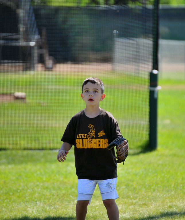 Daniel Newman plays ball with friends at Thorne-Rider park Sunday. The Sheridan Press/Kendra Cousineau