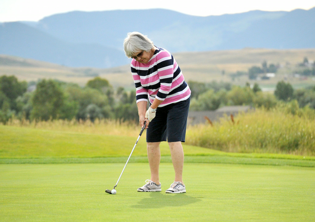 Pat Anderson stands over her ball before making her par putt during the Ladies City Golf League at the Powder Horn on Tuesday. The Sheridan Press|Mike Pruden