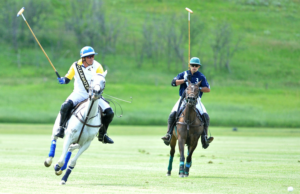 Hector Galindo, left, battles Carlucho Arellano for possession on Saturday at the Flying H Polo Club. The Sheridan Press|Mike Pruden
