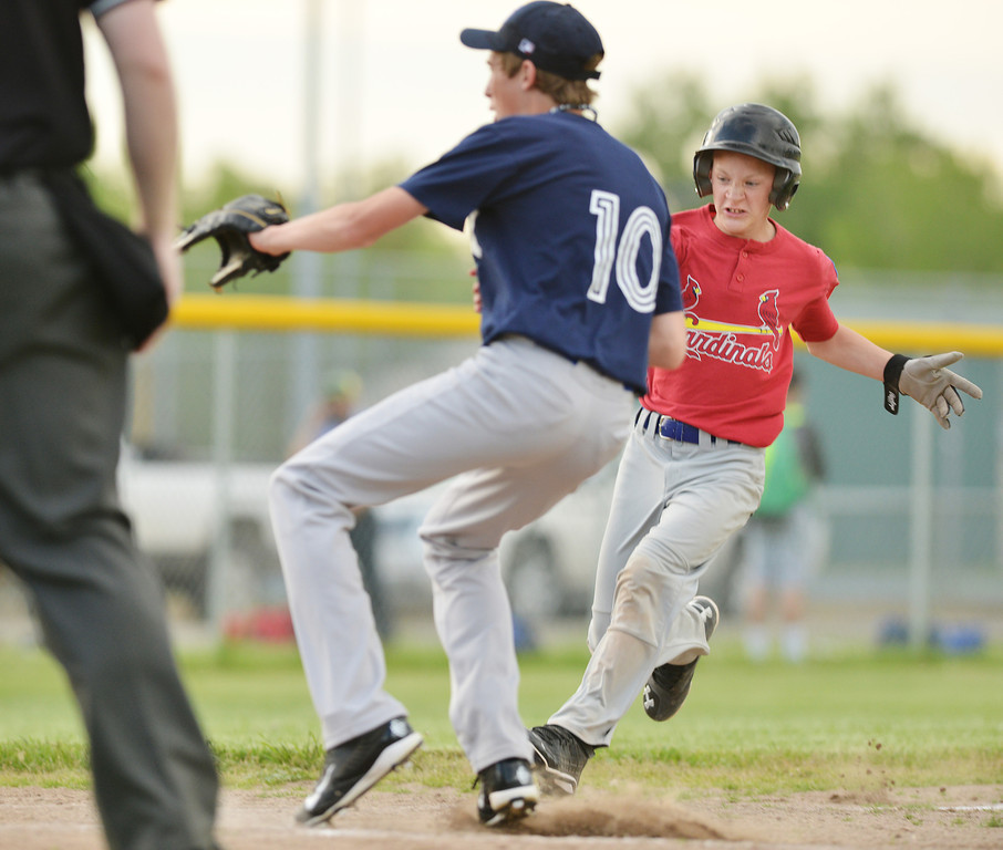 Cardinals' player Alec Riegert runs for home during Tuesday's Babe Ruth League game at Redle Field.