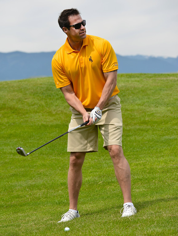 Former University of Wyoming student Colin Hardy readies himself to drive up to the hole during the Cowboy Joe Golf Tournament Saturday at the Powder Horn Golf Course.