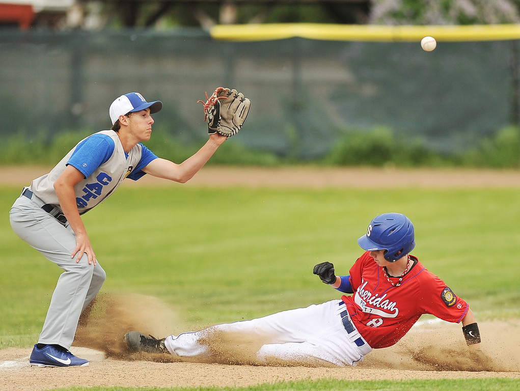 Sheridan Trooper Turner Martini, right, slides in to third base during the game against Douglas Thursday evening at Thorne Rider Stadium.