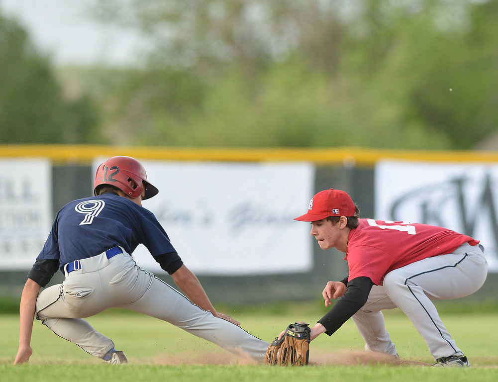 Cardinals' second base Will Timberlake, right, tries to pick off Yankees' infielder after an attempt to steal third base during Tuesday's Babe Ruth League game at Redle Field.