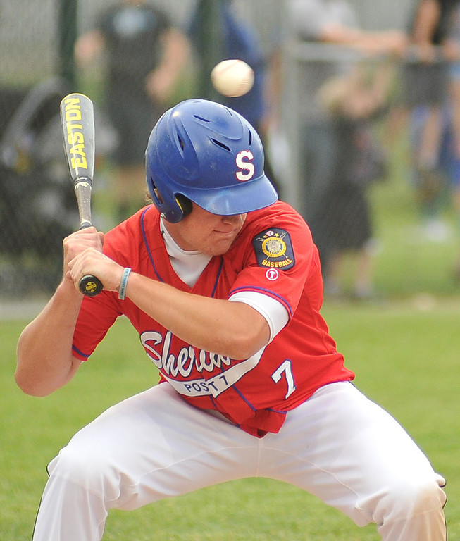 Sheridan Trooper Will Odell ducks the ball during the game against Douglas Thursday evening at Thorne Rider Stadium.