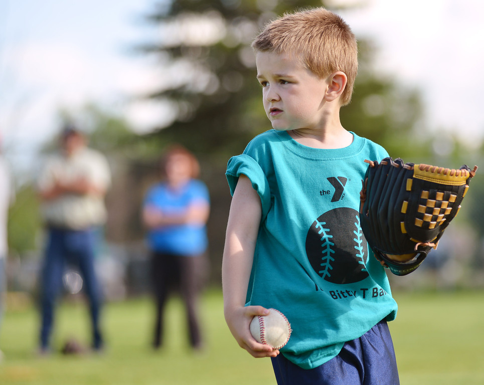 Four-year-old Brayden Bader listens to the coach during the opening day of Itty Bitty T-Ball Tuesday at the Sheridan YMCA.