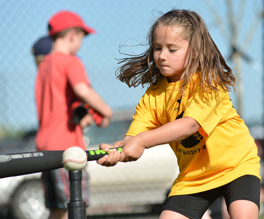 Five-year-old Avery Nikirk hits the ball during the opening day of Itty Bitty T-Ball Tuesday at the Sheridan YMCA.