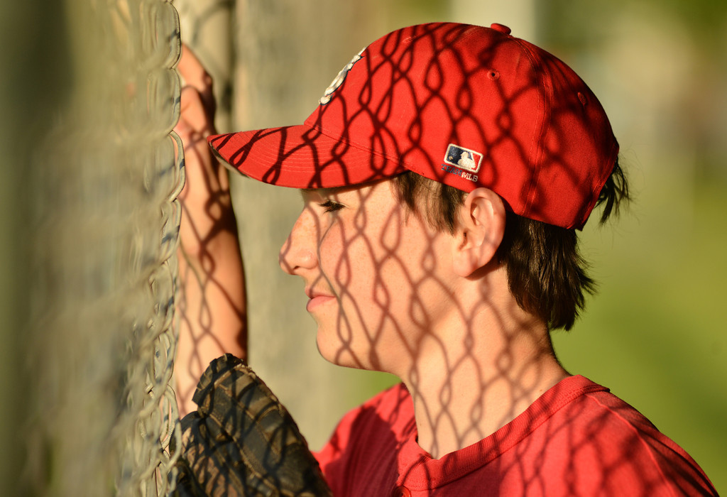 Kody Laing watches the action from the dugout during the Sheridan Babe Ruth League game Tuesday evening at Redle Field.