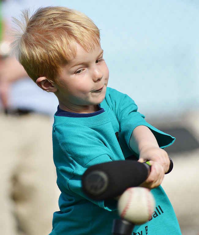 Four-year-old Aden Hulbert swings the bat during the opening day of Itty Bitty T-Ball Tuesday at the Sheridan YMCA.