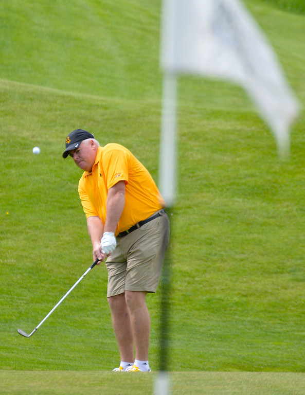 Jim Scott chips the ball up to the putting green during the Cowboy Joe Golf Tournament Saturday at the Powder Horn Golf Course.