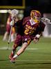 Boys High School Varsity Lacrosse. Ithaca Little Red at Corning Hawks.  April 10, 2014.