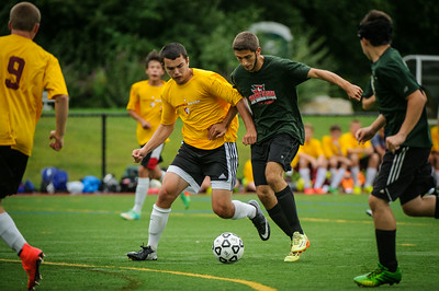 Varsity soccer scrimmage between Woodsville (green) and Derryfield (yellow) held on August 22, 2014 at the The Derryfield School in Manchester, NH.