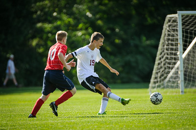 Varsity soccer match between Pittsfield (red) and Derryfield (white) held on August 29, 2014 at the The Derryfield School in Manchester, NH.