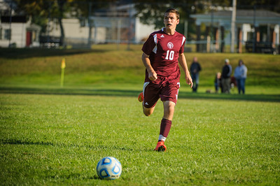 Varsity soccer between Pittsfield (white) and Derryfield (maroon) held on October 6, 2014 at the Drake Field in Pittsfield, NH.