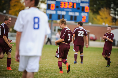 Varsity soccer between Epping (white) and Derryfield (maroon) held on October 15, 2014 at the Epping HS in Epping, NH.