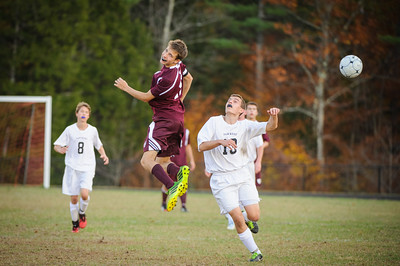 Varsity soccer between Moultonborough (white) and Derryfield (maroon) held on October 17, 2014 at the Moultonborough Academy in Moultonborough, NH.