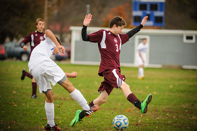 Varsity soccer between Hinsdale (white) and Derryfield (maroon) held on October 24, 2014 at the Hinsdale HS in Hinsdale, NH.
