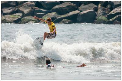 082114JTO_DSC_0281_Surfing-Vans Pro-Daniel Glenn hopping Takumi Yasut