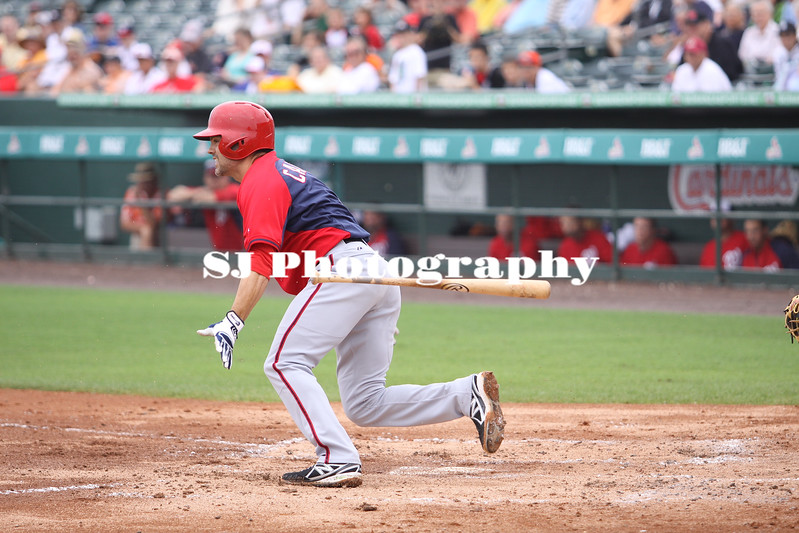 Jamey Carroll of the Minnesota Twins takes off for first base