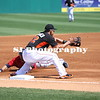 Brian Dozier of the Minnesota Twins slides into 3rd base as Derek Dietrich of the Miami Marlins waits to receive the ball