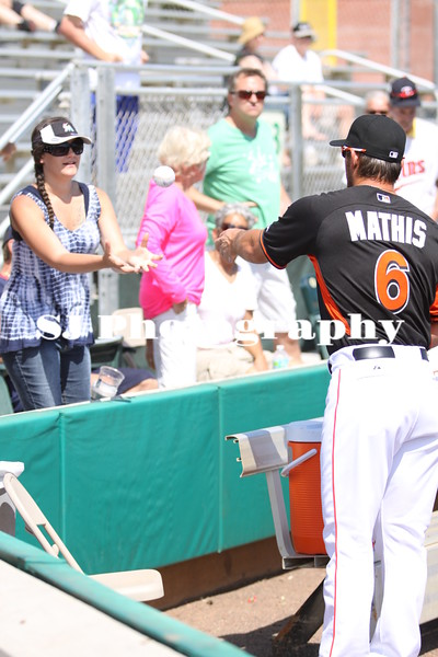 Jeff Mathis of the Miami Marlins signs a ball for a fan