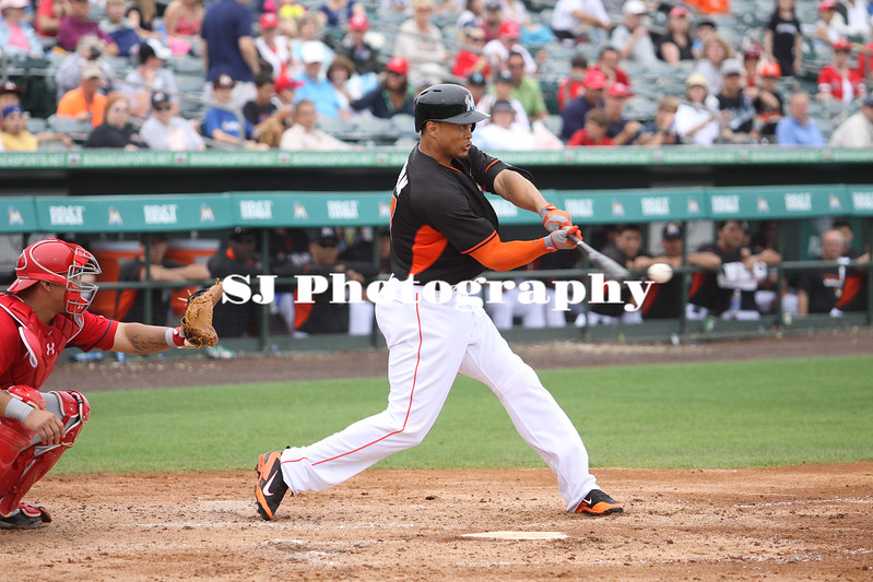 Giancarlo Stanton about to score to a hit
