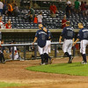 The Mbraves celebrate a Barrett Kleinknecht walk off hit in the bottom of the 12th inning