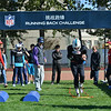 2014 NFL Home Field Beijing - Week 7 - Participants in the Running Back (RB) Challenge wear authentic football equipment while going through an offensive obstacle course.