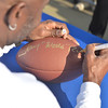 "2014 NFL Home Field Beijing - Week 9 - San Francisco 49ers Legend and NFL Hall of Fame Wide Receiver, Jerry ""World"" Rice signs footballs for visitors at NFL Home Field Beijing."