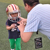 2014 NFL Home Field Guangzhou - Week 6 - Fans of all ages can try on authentic gear and enjoy the NFL Home Field experience.