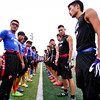 2014 NFL Home Field Guangzhou - Week 6 -  Flag football players from Guangzhou University of Chinese Medicine and Holley College of Guangdong University of Technology, line the field in preparation for their game.