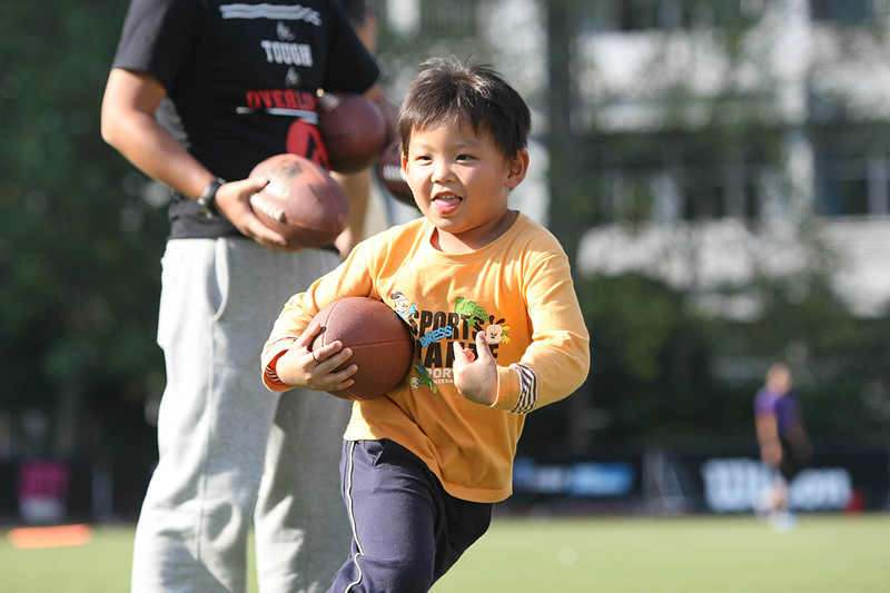 2014 NFL Home Field Shanghai - Week 6 - Young kids participate in UrGAMES Kids on field Flag Football Clinic to learn the basics of American football.