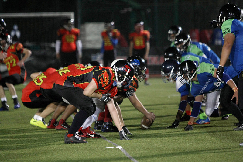 2014 NFL Home Field Shanghai - Week 8 - China U19  Sea Dragons and the Huali Terminators at the line of scrimmage before the ball is snapped.