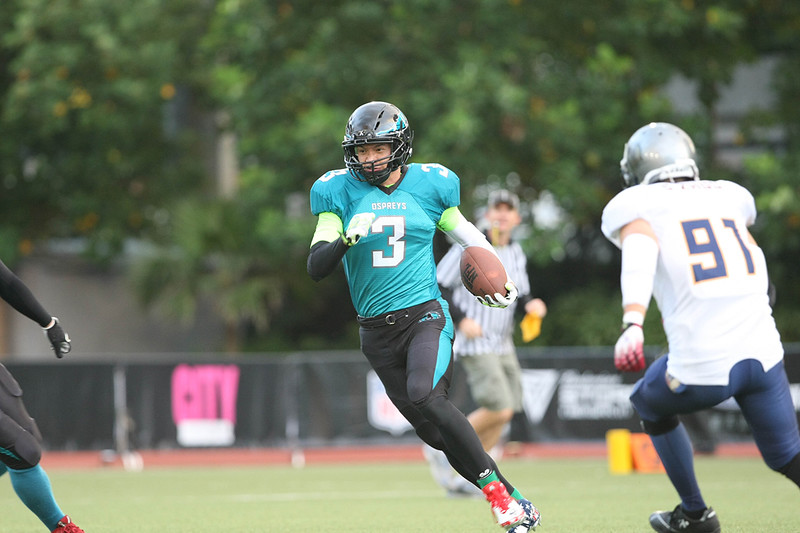 2014 NFL Home Field Shanghai - Week 2 - Hangzhou Ospreys quarterback, Zhou Mitao #3, scrambles to get past the Shanghai Titans defense.