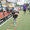 2014 NFL Home Field Shanghai - Week 2 - Participants in the Running Back (RB) Challenge wear authentic football equipment while going through an offensive obstacle course.