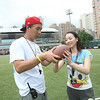 2014 NFL Home Field Shanghai - Week 2 - An NFL Play 60 clinic coach teaches a clinic participant the right way to hold and throw the football.