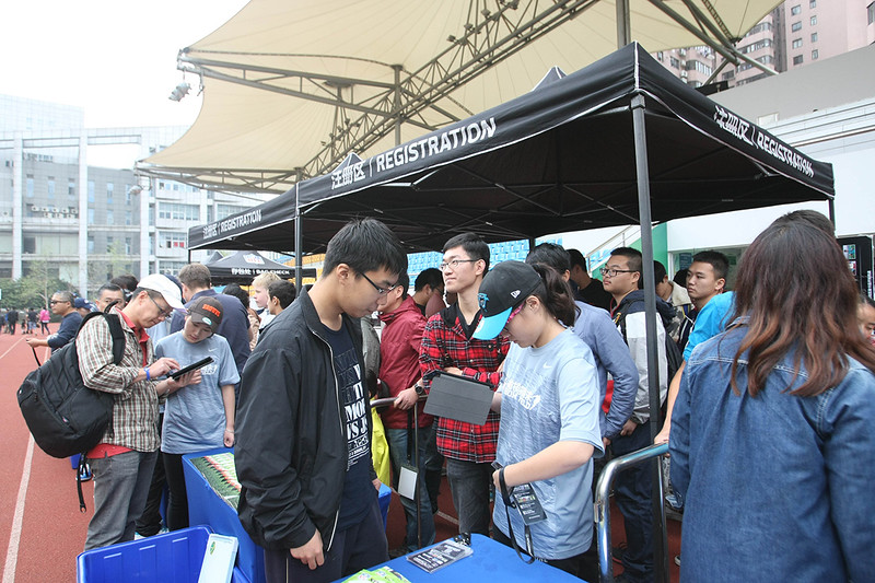 2014 NFL Home Field Shanghai - Week 7 - Volunteers help visitors register on-site. All visitors who register receive an NFL Home Field swipe card which is used to track and record individual scores in the NFL HOME FIELD Challenge at the various interactive games on-site. Visitors can then receive a print-out of their day's results as a souvenir.