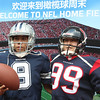 2014 NFL Home Field Shanghai - Week 2 - Visitor tries on authentic football equipment