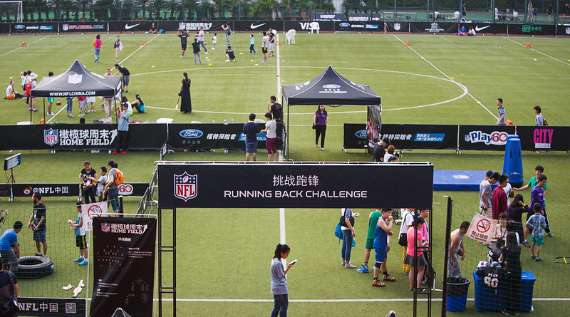 2014 NFL Home Field Shanghai - Week 3 - Visitors preparing for our on field clinics, learning the basics of American Football.