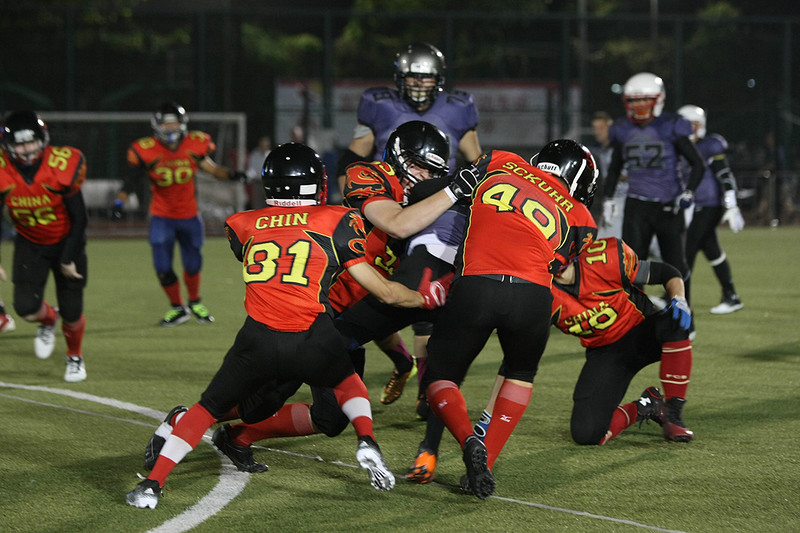 2014 NFL Home Field Shanghai - Week 4 - China U19  Sea Dragons defense tackle the Huali-Gongcheng University Combined Team's running back.